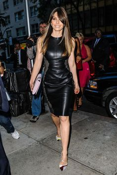 Jessica Biel on her way to an event wearing a veggie-leather dress with honeycomb side panels and multi-colored statement heels.