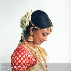 South Indian bride. Gold Indian bridal jewelry.Temple jewelry. Jhumkis. Cream white and gold silk kanchipuram sari with contrast red blouse.braid with fresh jasmine flowers. Tamil bride. Telugu bride. Kannada bride. Hindu bride. Malayalee bride.Kerala bride.South Indian wedding.