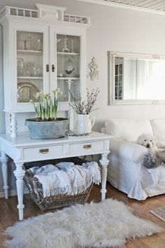 Sometimes I am so drawn to all white spaces although I'd never dare do this in my house! They would be all brown spaces within weeks. ;)