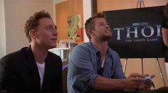 Tom and Chris playing the Thor video game. *gif* I love Tom's face :D He's completely fascinated, and then there's Chris who's basically yelling at the screen :D