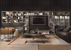 Modern wall units systems are sleek, stylish and offer a wide range of compositions, which serve our ever-changing habits and demands. Here are 8 modern show-stopping wall unit ideas that are perfect for your living room. Wall Entertainment Center, Wall Unit Designs, Modern Wall Units, Contemporary Bookcase, Ikea Billy Bookcase Hack, Living Spaces, Living Room, Furniture Design, Creations
