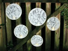 Another decoration idea. Lace fabric in embroidery hoops. (These ones have electric tealights glued in the bottom)