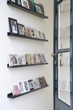Black shelves with frames and decorative letters | Styling Leonie Mooren | Photographer Anouk de Kleermaeker | vtwonen August 2015