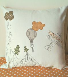 A flight in the mountains appliqued pillow cover on off white cotton. €35.00, via Etsy.