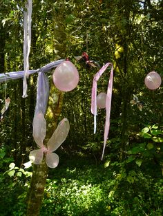 Fairy party decorations hanging in the forest