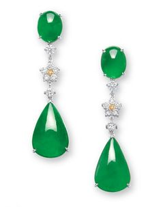 A PAIR OF JADEITE, DIAMOND AND COLOURED DIAMOND EAR PENDANTS   Each suspending a pear-shaped jadeite cabochon of bright emerald green colour and very good translucency, to the floral motif diamond link, surmounted by an oval jadeite cabochon of similar material, mounted in 18k white and yellow gold, largest cabochon approximately 18.7 x 12.3 x 4.0 mm, 4.9 cm long. Price realized: 325K HKD (USD 42,065)