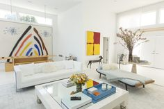 The interiors of the Hamptons house are mostly white, punctuated with Mr. Shvo's vast collection of contemporary art. In the living room a mother of pearl Karl Springer coffee table sits on a white cowhide rug. Arch Interior, Interior Architecture, Interior Design, Stylish Interior, White Cowhide Rug, Hamptons House, Eclectic Style, Minimalist Design, Living Room Decor