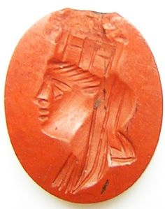 This is an ancient Roman hardstone intaglio, dating to the 2nd century A.D. It is cut on a wonderful red jasper gemstone, with a portrait of goddess Tyche, Greek goddess of luck or chance, known as Fortuna to the Romans, was a popular deity, especially in the Roman world. The benevolent blessings of Tyche/Fortuna were eagerly sought, especially in matters involving risk taking, contests, business or war...