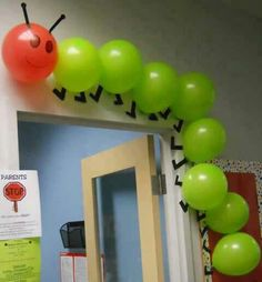 """Using balloons to create a classroom caterpillar is a creative idea. This would be great to use for """"The Very Hungry Caterpillar"""" by Eric Carle. Hungry Caterpillar Party, Caterpillar Craft, Counting Caterpillar, The Very Hungry Caterpillar Activities, Classroom Door, Eyfs Classroom, Classroom Themes, Classroom Birthday Displays, Butterfly Classroom Theme"""