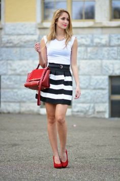 Gorgeous white sleeveless blouse with stripes cute skirt and dark red leather hand bag and high heels pumps and chain necklace