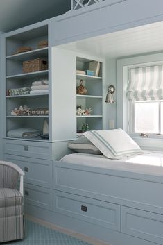 SCW Interiors - Gorgeous blue kid's room features a built-in window bed painted blue dressed in white and blue hotel bedding situated under window dresser in white and blue vertical stripe roman shade flanked by blue built-in shelves. Alcove Bed, Bed Nook, Built In Bed, Built Ins, Built In Dresser, Kids Bedroom, Bedroom Decor, Window Bed, Window Seats