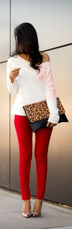 Stylish combination, red skinny jeans and white one shoulder shirt
