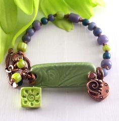 Bracelet Ceramic Bar Lime Copper with Lime Green Sun Charm, Copper Heart Charms, and Knotted Multicolor Beads. $42.00, via Etsy.