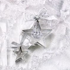 Cookie Cutter Ornaments        So simple to make, yet so pretty to admire, these star-shape ornaments begin with cookie cutters.