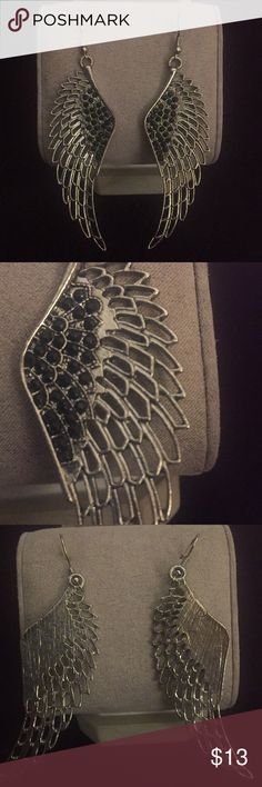 Angel wing earrings NWOT, never worn, feathered wing inspired earrings with black rhinestones. They are slightly heavy, but nothing crazy, just want to upfront about my sale! Jewelry Earrings