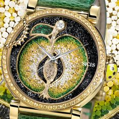A micromosaic apple with diamonds and yellow sapphires make of this watch the perfect summer jewel. See more of our Caravaggio collection.