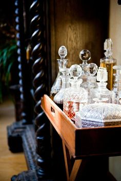 love the crystal liquor bottles on a tray.  perfect for second shelf on white cabinet in D R