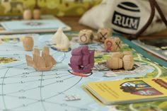 In Rumsmuggler board game a bunch of watchful scamps try to smuggle rum into the royal ports, while the duty of the King's honourable sailors is to seize their illegal cargoes, meantime they all try to avoid the threats of the sea, like monsters, reefs, g…
