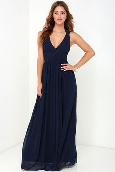 The Strike a Minerva Navy Blue Maxi Dress is bound to hit a high note and win its way into your good graces in no time at all! This chiffon dress features a highly pintucked triangle bodice, with double shoulder straps emerging from the peaks, and wrapping above your shoulders and behind your neck with a chic two-button closure. The skirt gathers at the waist and reaches down to an elegant maxi length. Hidden back zipper/clasp closure. Fully lined. 100% Polyester. Dry Clean Only.