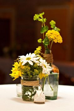 rustic country yellow and white wildflowers wedding centerpiece / http://www.himisspuff.com/boho-rustic-wildflower-wedding-ideas/6/