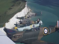 Amazing photo by Andy Saunders, when he got to see Spitfire Mark I P9374 fly *very* close. A true WW2 legend!