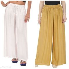 Palazzos Women's Solid Pack of 2 Palazzo Fabric: Rayon Waist Size: Up To 28 in To 42 in (Free Size ) Length: Up To 39 in Type: Stitched Description: It Has 2 Pieces Of Women's Palazzos  Pattern: Solid Country of Origin: India Sizes Available: Free Size, 28, 30, 32, 34, 36, 38, 40   Catalog Rating: ★4.1 (457)  Catalog Name: ⭐New Fabulous Rayon Women's Palazzos Vol 15 CatalogID_558588 C79-SC1039 Code: 273-3960394-