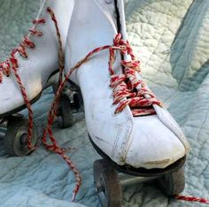 Vintage Roller Derby skates from the 1960s with metal wheels and red and white laces, size 7. $19.50, via Etsy.