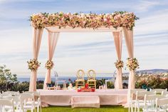 Planned by Chic Productions, Khusbuand Rajeev's Ritz Carlton Laguna Niguel wedding was a dream come true with romantic blush and gold details.