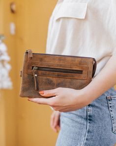 Our pretty leather clutch bag is a must-have accessory for this season. We've thoughtfully designed this clutch bag for those who like to keep their essentials compact. Leather Hobo Bags, Leather Saddle Bags, Leather Bags Handmade, Easy To Love, Women's Handbags, Womens Purses, Distressed Leather, Vegetable Tanned Leather, Leather Accessories