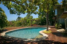 Kidney shaped pool with wood deck, pool stone coping, stairs and bench; blending natural colors of wood and stone. Backyard Pool Landscaping, Swimming Pools Backyard, Swimming Pool Designs, Pool Decks, Lap Pools, Indoor Pools, Landscaping Ideas, Patio, Wood Pool Deck