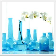 Blue Vintage Bottles- great for vases or centerpieces  This goes with my blue glass collection, it's just so pretty!