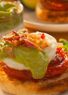 Lighter than hollandaise but just as rich and creamy, this flavorful avocado sauce makes delicious eggs benedict with roasted tomatoes and crumbled bacon. Avocado Eggs Benedict, Eggs Benedict Recipe, Sweet Potato Dinner, Appetizer Sandwiches, Appetizers, Spicy Grilled Chicken, Honey Glazed Chicken, Spicy Honey, Brunch Recipes