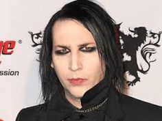 Marilyn Manson denies dating Avril Lavigne Marilyn Manson, Divorce, Marriage, Olympic Swimming, Jean Reno, Nu Metal, Believe In God, Avril Lavigne, Twiggy