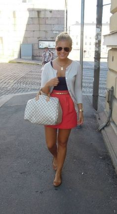navy top, white cardigan, pink skirt with belt topped off with nude flats