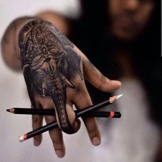 I really like this one.  Hand Tattoos | Finger Tattoos - Inked Magazine