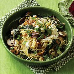 Winter Greens and Mushroom Pasta | MyRecipes.com  A ricotta cheese topping adds lushness without a lot of fat.
