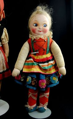 Collection of three cloth and papier mache dolls 1 glass eyes