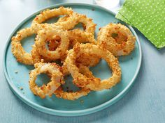 Oven-Baked Onion Rings : Forgo the deep fryer for a baking sheet and you'll be churning out healthier onion rings in no time. A baked potato chip and low-fat buttermilk coating complete these crunchy snacks.