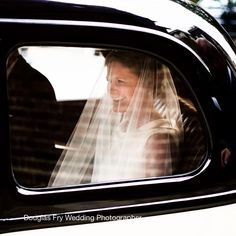 Bride arriving at Chelsea Old Church by vintage car