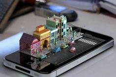3D artist Mike Ko produced a cool live action animation, titled iPhone Diorama