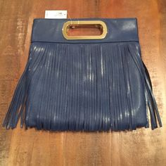 Dark blue fringe open handle purse  Brand new with tags dark blue fringe purse. Beautiful gold accents. Button close top and 1 zip pocket on inside. ❤️ NO TRADES. NO PP. BUNDLE= 15% discount on 2 or more items. I will NOT negotiate in the comments section. Only offers made with the offer button will be considered. Jessica McClintock Bags Clutches & Wristlets