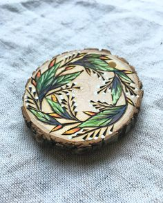 Floral wreath Freehand pyrography hand painted necklace on a wood pendant - available one of a kind on etsy Pyrography, wood burning, wood burnt, pendant A personal favorite from my Etsy shop https://www.etsy.com/listing/468479064/floral-wreath-hand-painted-pyrography
