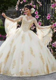 Get the beautiful Metallic Lace Appliqué Quinceañera Ballgown by Morilee 34021 and other amazing Morilee quinceanera dresses on Mi Padrino. Royal Dresses, Quince Dresses, Ball Gown Dresses, 15 Dresses, Dresses With Sleeves, Rose Gold Quinceanera Dresses, Gold Wedding Gowns, Colored Wedding Dresses, Bridal Gowns