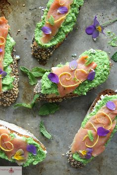 Smoked Salmon, Minty Pea and Goat Cheese Crostini. Garnish with mint and lemon zest