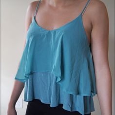 Flowy thin strap tank top blouse Teal thin strap tank top blouse from a boutique in CT called Caren Forbes. Looks great under a casual blazer and can be dressed up or down. Great condition and has great movement! Caren Forbes Tops Tank Tops