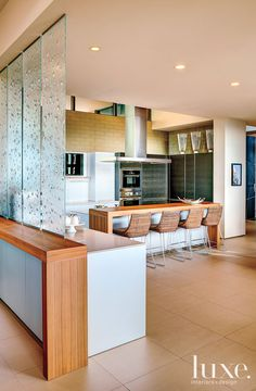 #Glass panels visually separate this #Arizona #kitchen from the adjacent #dining area. See more at www.luxesource.com. #luxe #luxemag #luxury #design #interiordesign #interiors #home #house #dwelling #residential #decor #homedecor #interiordecorating #interiordesignideas #architecture #modern