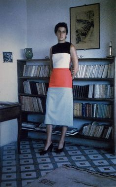 Anne Weber wearing the dress she sewed that was designed by abstract artist Ellsworth Kelly in 1952.