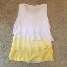 Pretty yellow and white tank Worn once. There are two marks on the back that you can barely see. Says Xl but fits like a medium. See through. Very flowy and comfy. Dress it up or down. Tops Camisoles