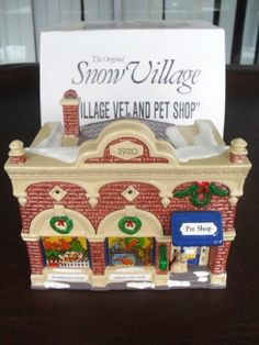 Retired Dept 56 Snow Village  Village VET  and PET Shop -- Check out this great product.