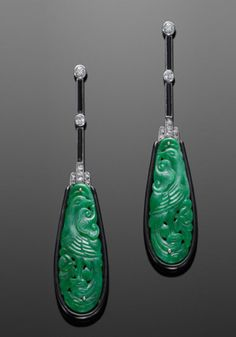 18K White Gold Art Deco Carved Jade, Onyx and Diamond Pendant Earrings.  Carved jade plaques of bird and floral design are suspended from onyx and diamond lines, mounted in 18K white gold with black enamel borders.